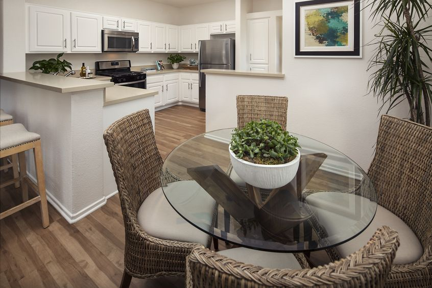 Interior view of kitchen and dining area at Torrey Hills Apartment Homes in San Diego, CA.
