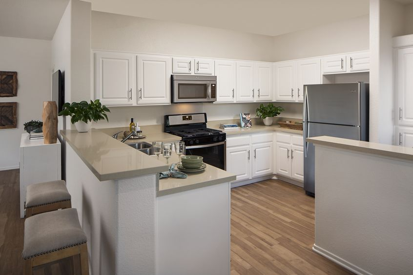 Interior view of kitchen at Torrey Hills Apartment Homes in San Diego, CA.