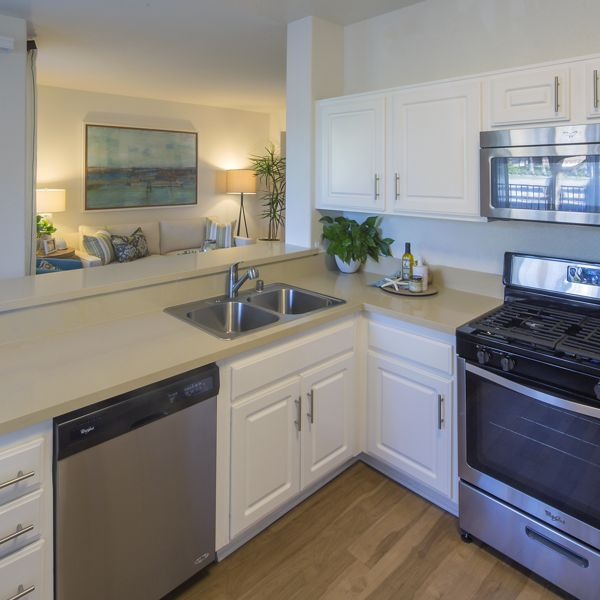 Interior view of kitchen and living area at Torrey Hills Apartment Homes in San Diego, CA.
