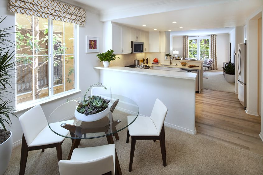 View of kitchen and dining room at Torrey Ridge Apartment Homes in Carmel Valley, CA.