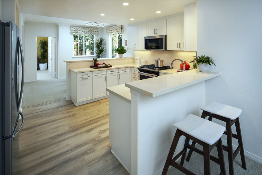 View of kitchen at Torrey Ridge Apartment Homes in Carmel Valley, CA.