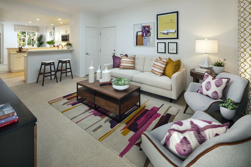 Interior view of living room and kitchen at Torrey Ridge Apartment Homes in Carmel Valley, CA.