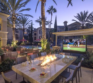 Exterior view of outdoor patio area at Torrey Villas Apartment Homes in San Diego, CA.