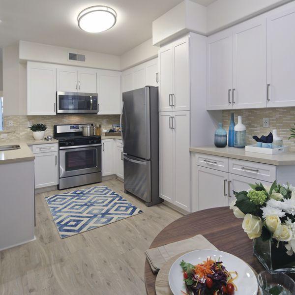 Interior view of kitchen at Torrey Villas Apartment Homes in San Diego, CA.