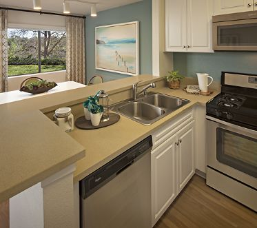 Interior view of kitchen at Westwood Apartment Homes in San Diego, CA.
