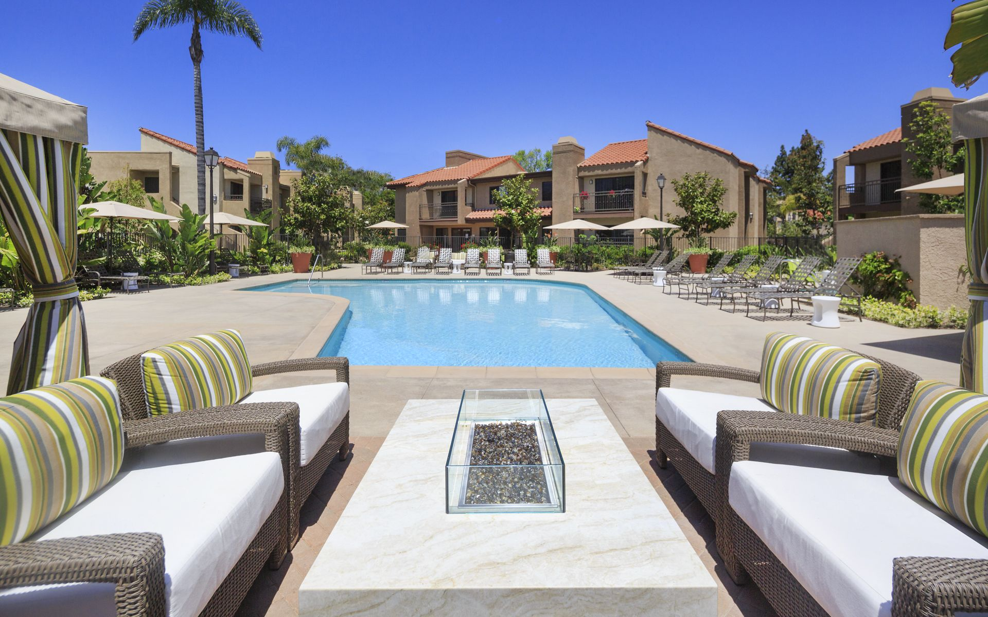 Exterior view of pool at Westwood Apartment Homes in San Diego, CA.