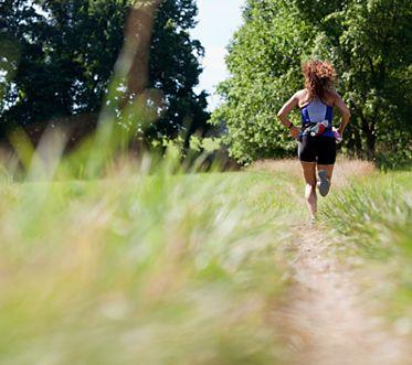 Woman running along path