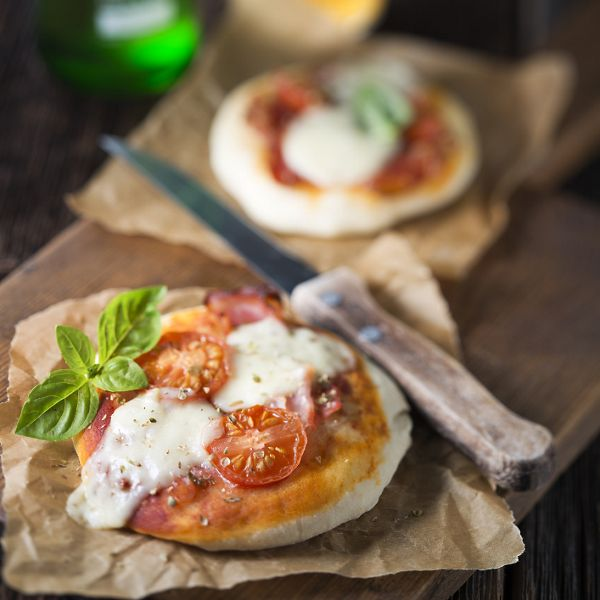 Small pizzas and beer close up shoot