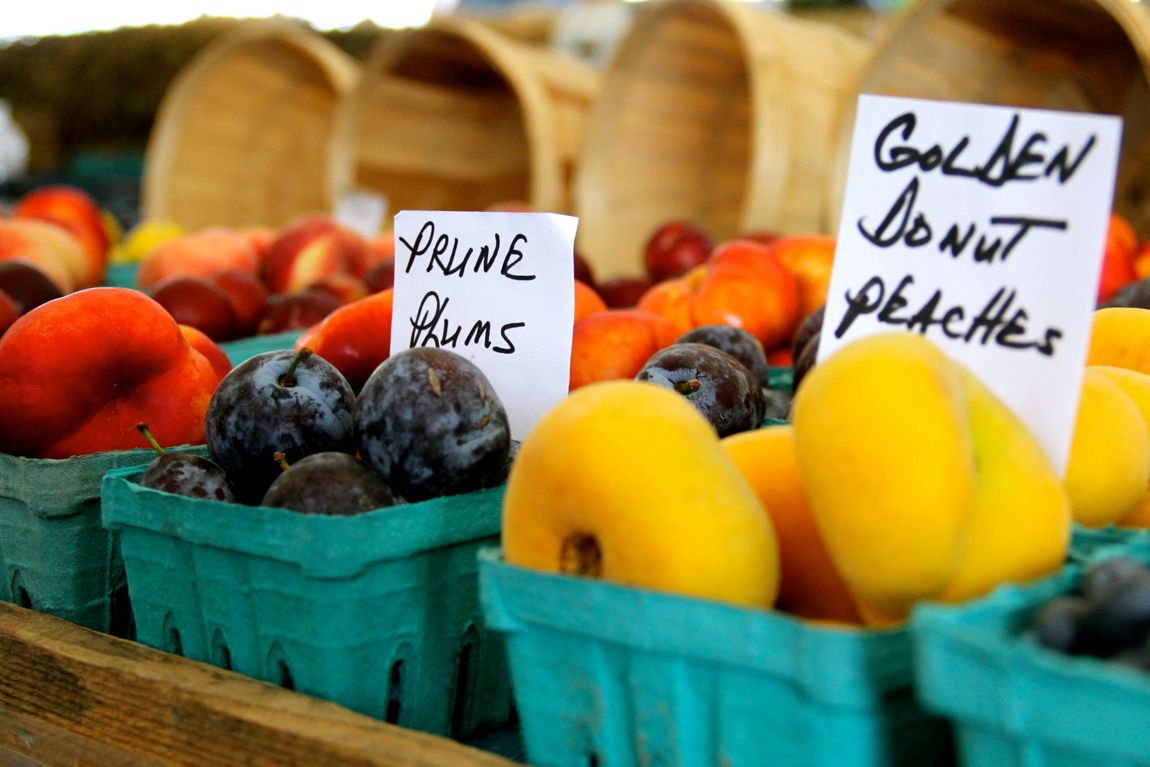 Baskets of fresh fruit for sale at a local farmer's market
