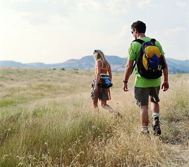 Stock image of man and woman hiking - Woodbury Court Apartment Homes in Irvine, CA