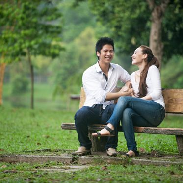 Attractive Asian Couple dating in the park; Shutterstock ID 128714135; PO: 3996; Job: ICAC306643; Client: Irvine Company