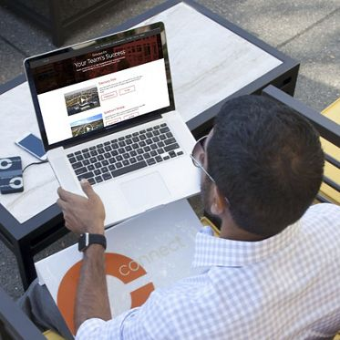 View of man on his laptop on the customized website.