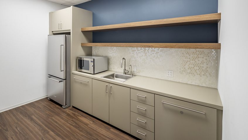 Interior view of conference center kitchen at Irvine Towers in Irvine, CA.