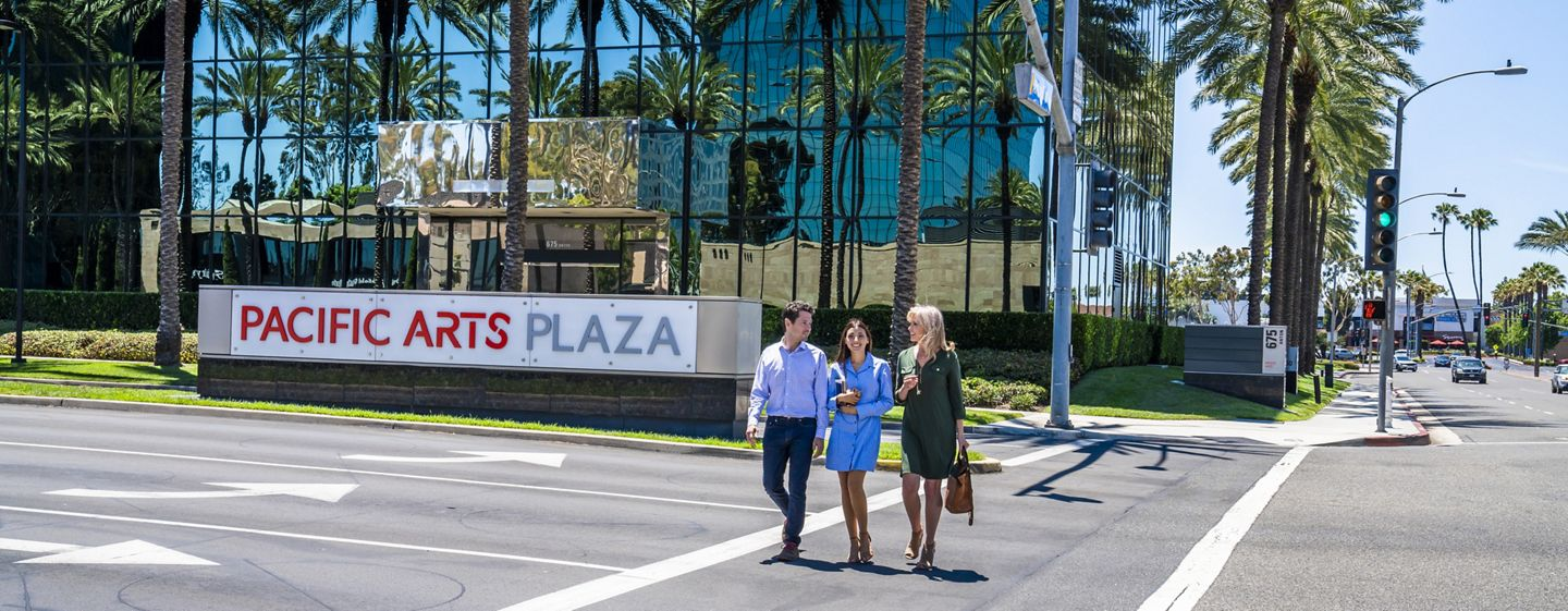 Lifestyle photography of Pacific Arts Plaza, featuring monument signage for the workplace community in Costa Mesa, CA
