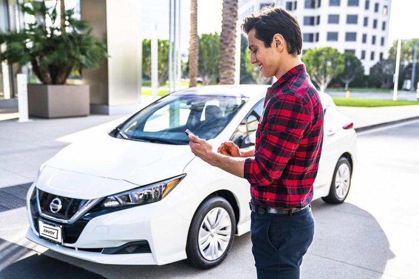 Lifestyle photography of Envoy on-demand electric vehicles at 400 Spectrum Center Drive in Irvine, CA