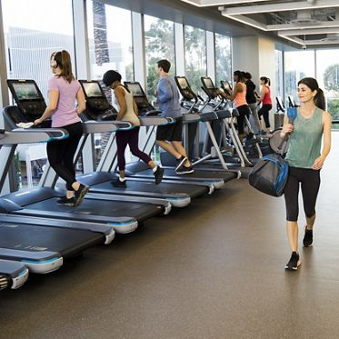 Lifestyle photography of KINETIC fitness center offering at 400 Spectrum Center, Irvine, Ca