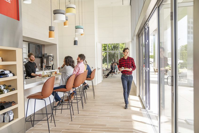 Lifestyle photography of The Patio Marketplace cafe at 400 Spectrum Center Drive in Irvine, CA