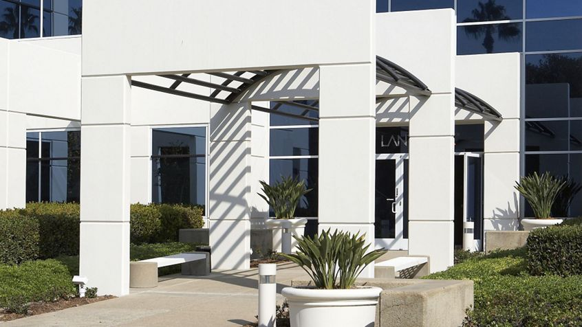 Exterior view of the15353 Barraca Parkway office building at Barranca. Santoni 2009. Shared Drive Submission - November 18, 2009.