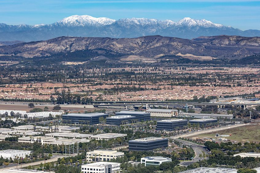 Aerial photography of Discovery Park featuring snowy mountains in Irvine, CA