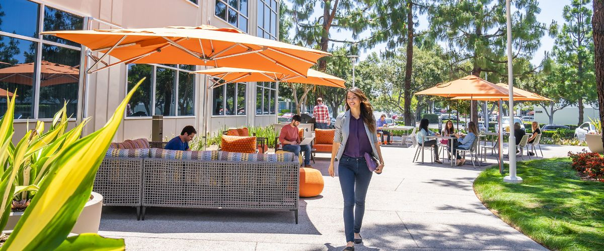 Lifestyle photography of the outdoor workspace between 1 and 3 Ada at Lakeview Business Center in Irvine, CA