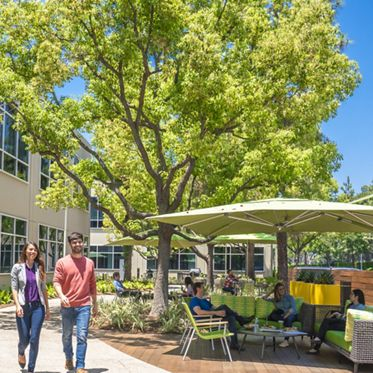 Lifestyle photography of the outdoor workspace between 15300 and 15310 Barranca Parkway at Lakeview Business Center in Irvine, CA