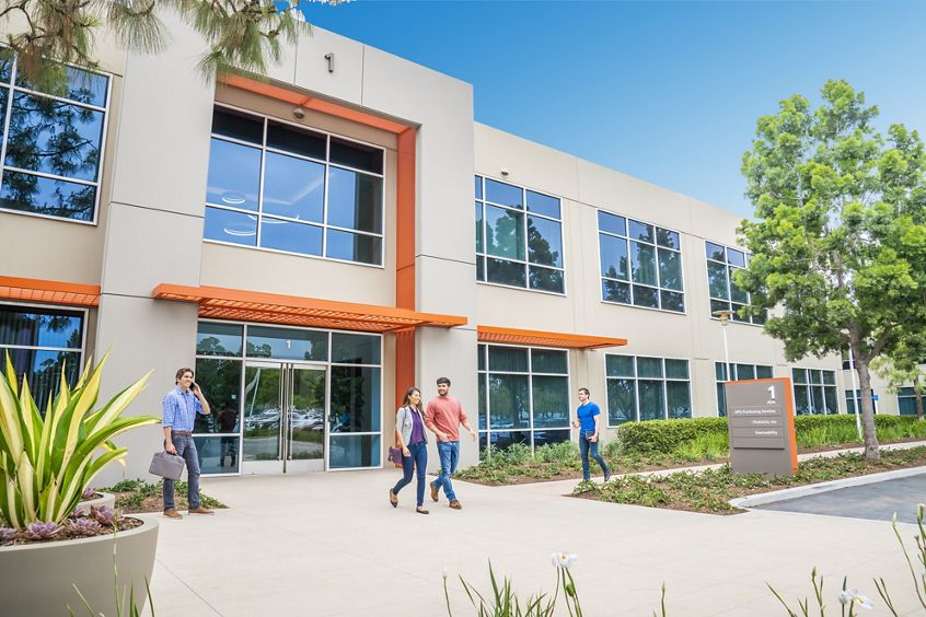 Lifestyle photography of the building entry at Lakeview Business Center - 1 Ada Parkway in Irvine, CA