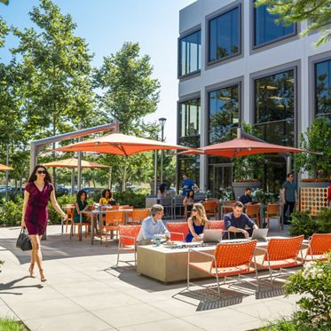Lifestyle photography of Citrus Court, the outdoor workspace between 5290 and 5270 California Avenue at UCI Research Park in Irvine, CA