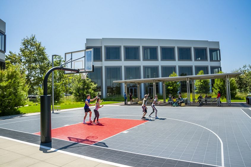 Lifestyle photography of the basketball court between 5281 and 5271 California Avenue at UCI Research Park in Irvine, CA