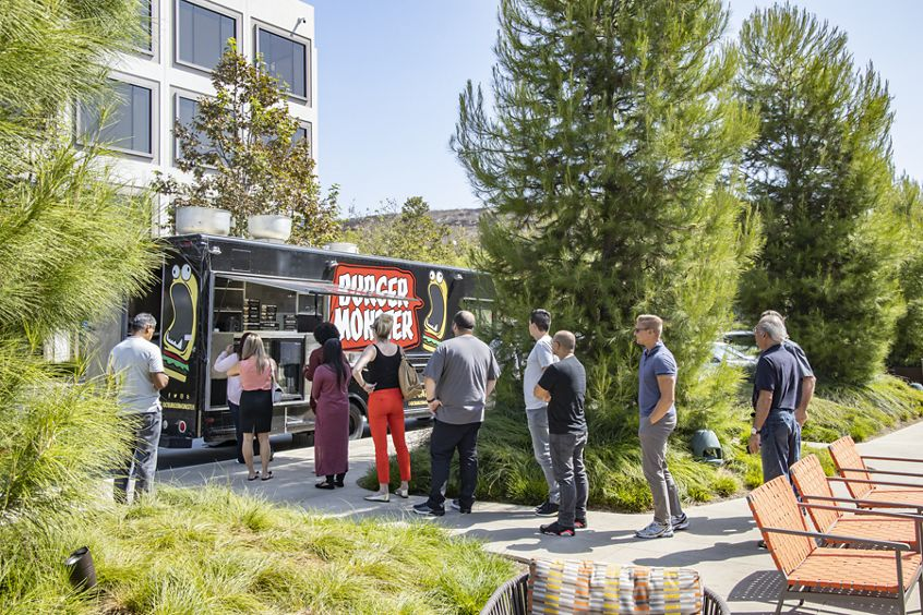 Lifestyle photography of the food trucks and people dining at The Commons at UCI Research Park in Irvine, CA
