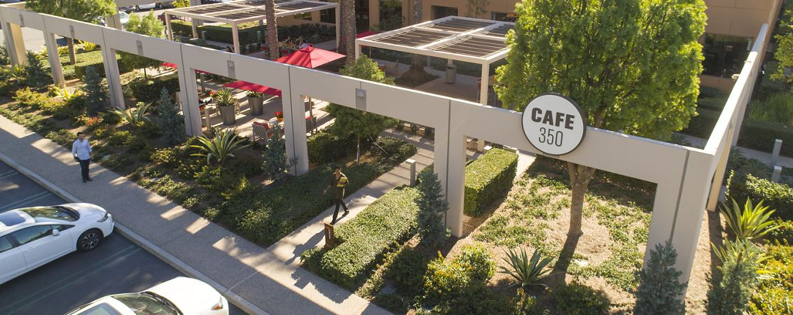 Aerial photography of The Commons featuring Cafe 350 signage and new rollup door at Market Place Center in Irvine, CA