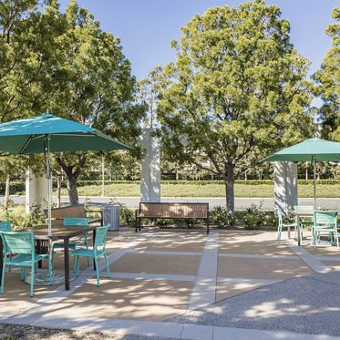 Exterior view of seating area at The Commons at 210 Commerce at Market Place Center in Irvine, CA.