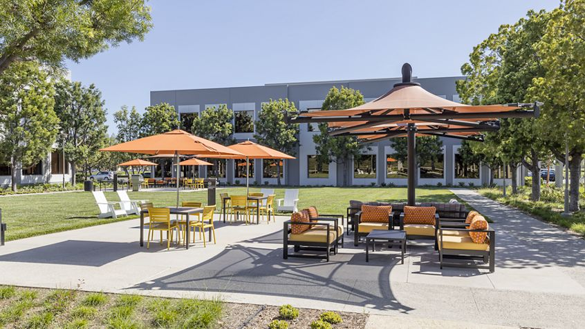 Exterior view of seating area at The Commons at 220 Commerce at Market Place Center in Irvine, CA.