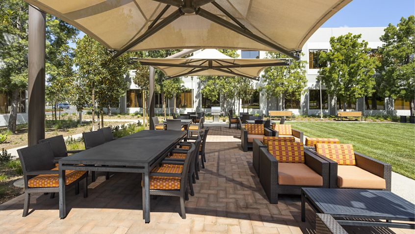 Exterior view of seating area in The Commons at 420 Exchange at Market Place Center in Irvine, CA.
