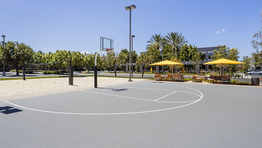 Exterior view of volleyball and basketball courts at The Commons at 420 Exchange at Market Place Center in Irvine, CA.