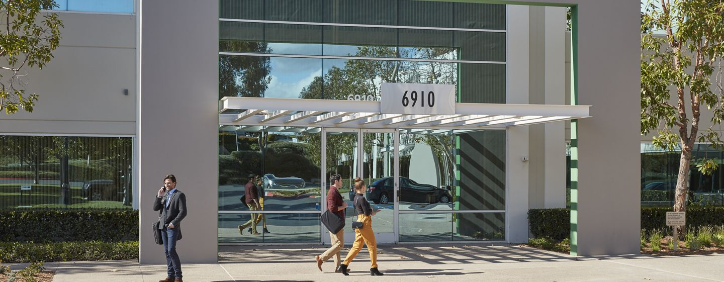 Lifestyle photography of the building entry at Canyon Ridge Technology Park - 6910 Carroll Road in San Diego, CA