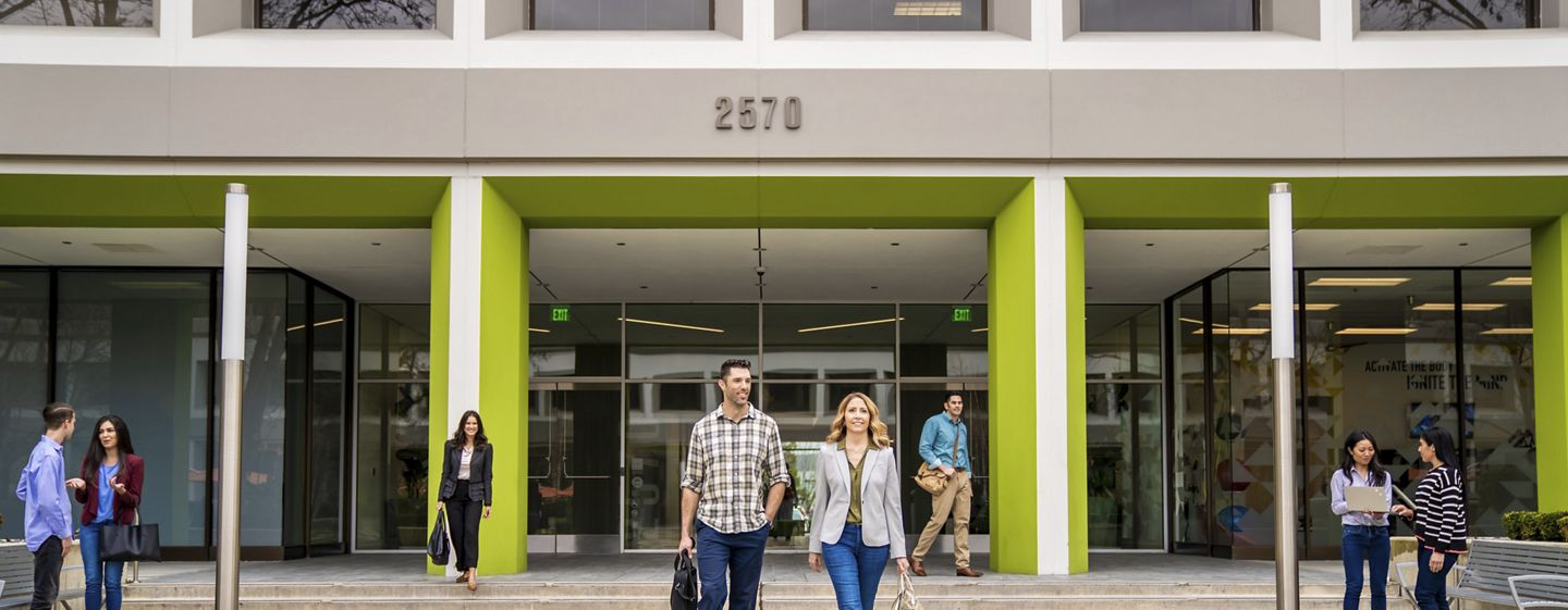 Lifestyle photography of the building entrance of SIlicon Valley Center - 2570 N First Street in San Jose, CA