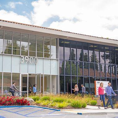 Lifestyle photography of the building entry at Santa Clara Park at Freedom Circle - 3900 Freedom Circle in Santa Clara, CA