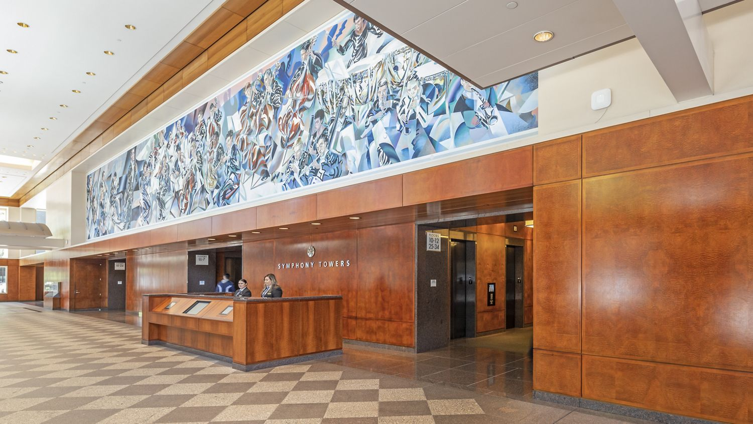 Before reinvestment photography of the lobby at Symphony Towers - 750 B Street in San Diego, CA